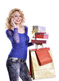 Modern young woman shopping and talking on cell Stock Photography