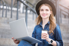 Modern young woman using technologies Stock Image