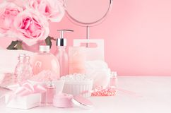 Modern youth bathroom or dressing table design in pastel pink color -  flowers, cosmetic products, bath accessories, jewelry. Modern youth bathroom or dressing royalty free stock photo