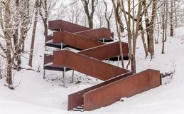 A modern zig-zag stairway in the snow. stock image