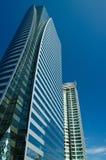 Moderna byggnader under blå himmel Fotografering för Bildbyråer