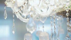 Moderna Crystal Chandelier Stäng sig upp på kristallen av en modern ljuskrona