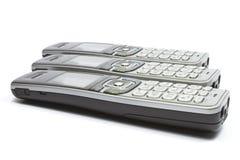Moderna digitala telefonlurar för sladdlös telefon på vit bakgrund Arkivbild