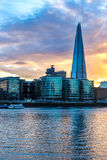 Moderna London på solnedgången Arkivbild