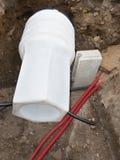 Moderna plast- böjliga rör för vatten, för elkraft och för gass arkivfoto