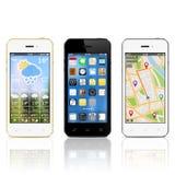 Moderna smartphones med manickar på skärmar Arkivbild