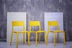 Moderna stolar på bakgrund Royaltyfri Foto