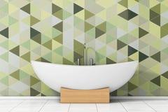 Moderna vita Bathtube framme av Olive Green Geometric Tiles in Arkivfoto