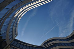 Moderne Architecture. With airplane above in blue sky Stock Image