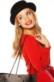 Moderne Blondine, die den - Schulter Blick übergibt. Lizenzfreie Stockfotografie
