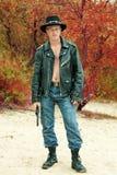 Moderne cowboy met de revolver Stock Foto