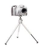 Moderne digitale camera met driepoot stock fotografie