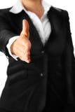 Moderne Geschäftsfrau dehnt heraus Hand für Hände aus Stockfotos