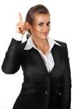 Moderne Geschäftsfrau mit dem rised Finger. Idee gest Lizenzfreie Stockbilder