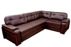 moderne grote comfortabele stoffen bank-hoek van chocoladekleur met witte naden op een witte achtergrond stock afbeelding