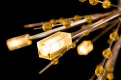 Moderne High-tech die kroonluchter met kristallen op zwarte worden geïsoleerd Royalty-vrije Stock Afbeeldingen
