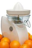 Moderne juicer en sinaasappelen Royalty-vrije Stock Foto