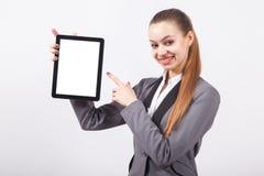 Moderne junge Geschäftsfrau in einem Anzug auf einem weißen backgr Stockfotos