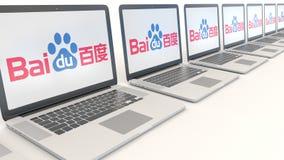 Moderne Laptops mit Baidu-Logo Wiedergabe des Computertechnologiebegriffsleitartikels 3D Lizenzfreie Stockfotos