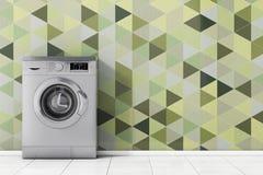 Moderne metallische Waschmaschine vor Olive Green Geometric Lizenzfreie Stockfotos