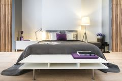 Moderne modieuze slaapkamer stock afbeelding