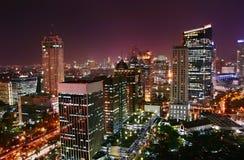 Moderne nachtstad stock afbeelding