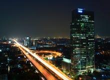 Moderne stad bij nacht Stock Foto's