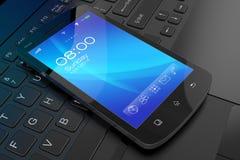 Moderne touchscreen smartphone op laptop. Stock Foto's