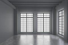 Moderne videz la pièce de grenier avec les murs gris, le plancher et grand concrets images stock