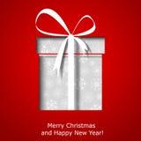 Moderne Weihnachtsgrußkarte mit Weihnachtsgeschenkbox Lizenzfreie Stockfotos