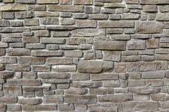 Moderne Weinlese-Steinwand von getretenem Granit blockiert Hintergrund Lizenzfreies Stockfoto