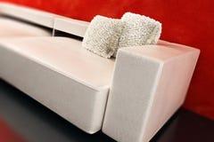Moderne Wiedergabe der Couch 3D Stockbilder