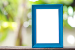 Moderner Bilderrahmen gesetzt auf einen Bretterboden Lizenzfreie Stockbilder