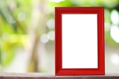 Moderner Bilderrahmen gesetzt auf einen Bretterboden Lizenzfreies Stockfoto