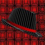 Moderner Fedora-Hut auf abstraktem rotem Hintergrund Stockfoto
