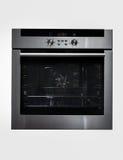 Moderner metallischer Ofen lokalisiert stockfotografie