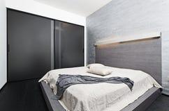 Moderner Minimalismusart-Schlafzimmerinnenraum Stockbilder
