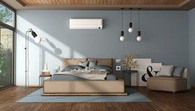 Modernes blaues und braunes Hauptschlafzimmer Stockfotografie