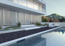 Modernes Luxushaus mit Swimmingpool stock abbildung