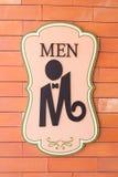 Modernes Zeichen auf der Backsteinmauer der Toilette Lizenzfreie Stockfotos