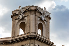Modernist eagle statues. Early 20th century Italian modernist eagle statues on top of the monumental entrance to the Via Roma, built 1936 on the Piazza Giulio Stock Photo