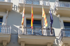 Modernist facade building from barcelona. With flags Stock Images