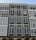 Modernist facade details among white wood galleries. La Coruna, Spain. royalty free stock photography