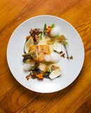 Modernist Fish Plate. Modern plating of sea bass with assorted mushrooms, asparagus, nuts and dill Royalty Free Stock Photos