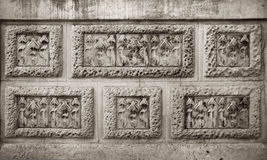 Modernist flowers carving in  stone wall. Detail of modernist flowers carving in stone wall rectangles Royalty Free Stock Images