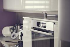 Modernist kitchen. Old silver stylish pepper mill in modernist kitchen royalty free stock photo