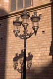 Modernist lamppost. With his shadow in the Gothic Quarter of Barcelona, Spain royalty free stock photo
