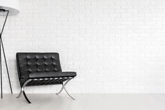Modernist lounge seat in a post industrial interior Royalty Free Stock Photos