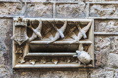 Modernist mailbox made of stone, Barcelona. Modernist mailbox made of stone decorated with turtles, birds and leaves in the Gothic Quarter in Barcelona Royalty Free Stock Photography