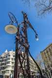 Modernist style streetlight and La Pedrera, Barcelona Royalty Free Stock Photos